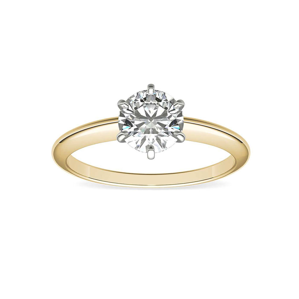 Two tone knife edge engagement ring with round brilliant diamond