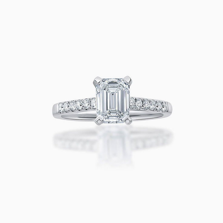 Emerald cut diamond engagement ring on a pave band