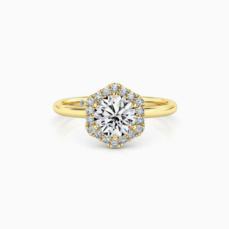 Round Brilliant cut diamond with a hexagon shape halo