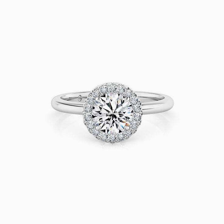Round brilliant cut diamond with a 3d halo engagement ring