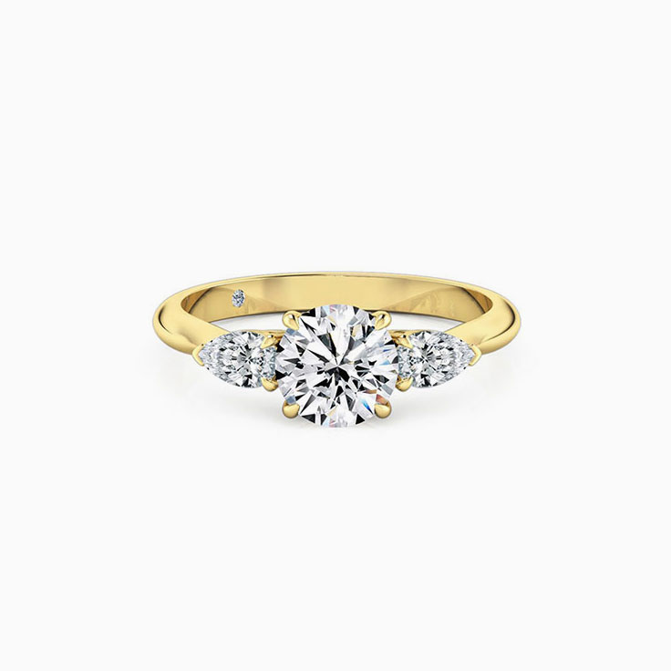 Round Diamond With side pear cut  Engagement Ring