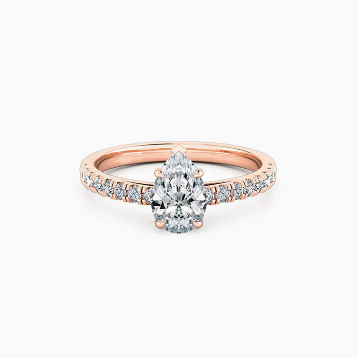Pear cut diamond engagement ring set on a diamond band