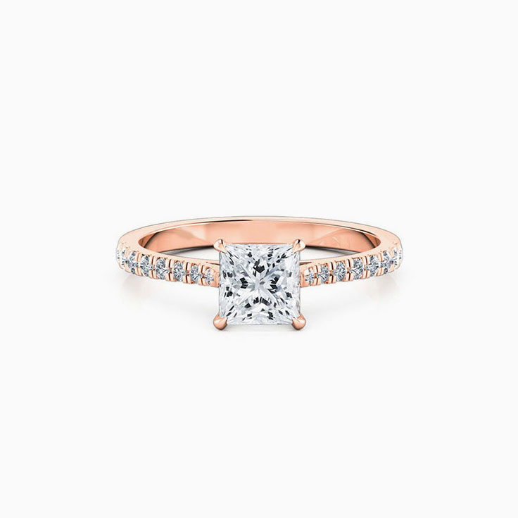 Princess cut diamond in four claw set engagement ring