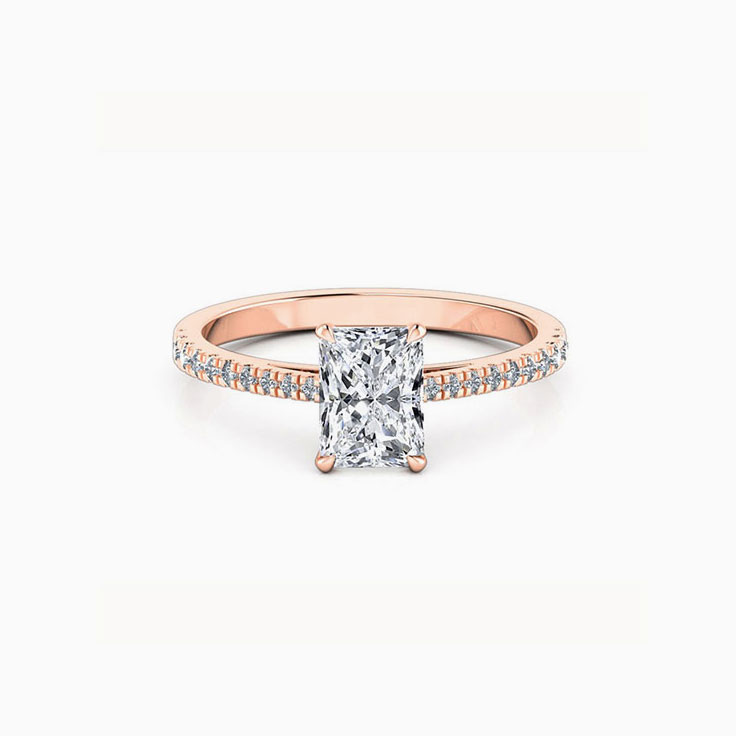Radiant cut diamond engagement ring on a diamond band