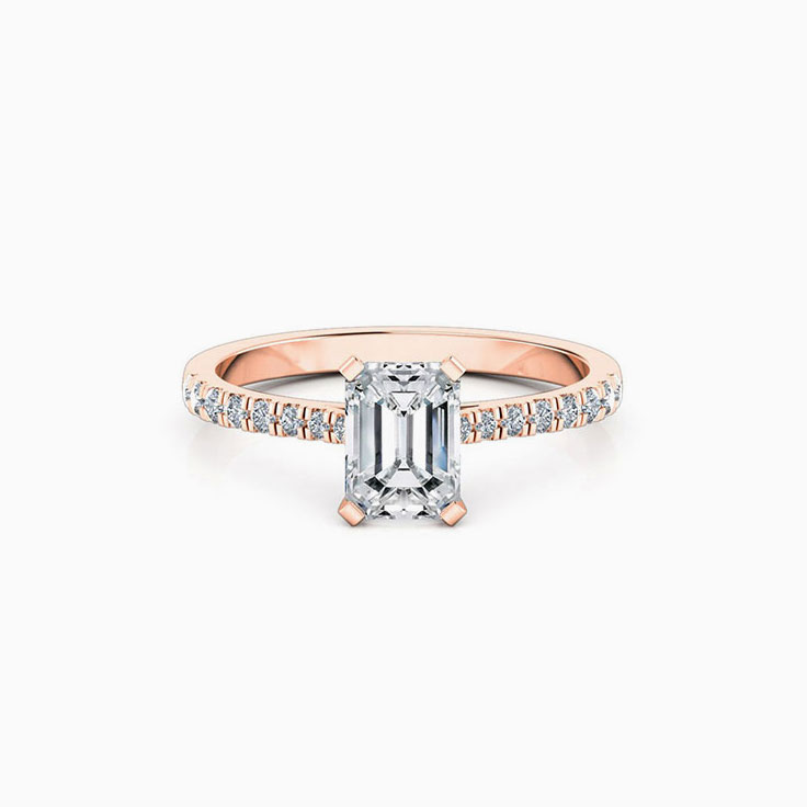 Emerald Cut Engagement Ring On A Pave Band