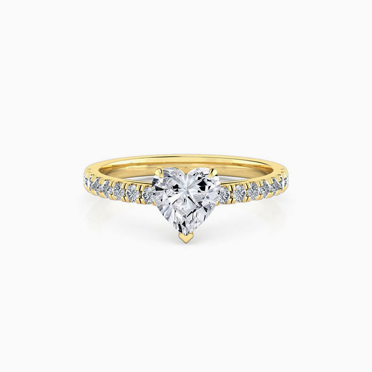 Heart shape diamond engagement ring on a diamond band