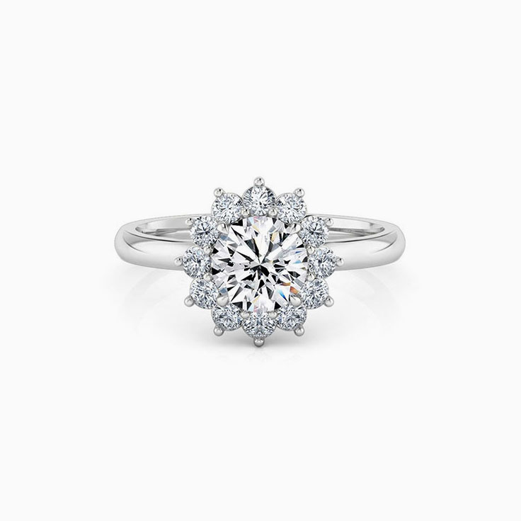 Round brilliant cut engagement ring with floral halo setting
