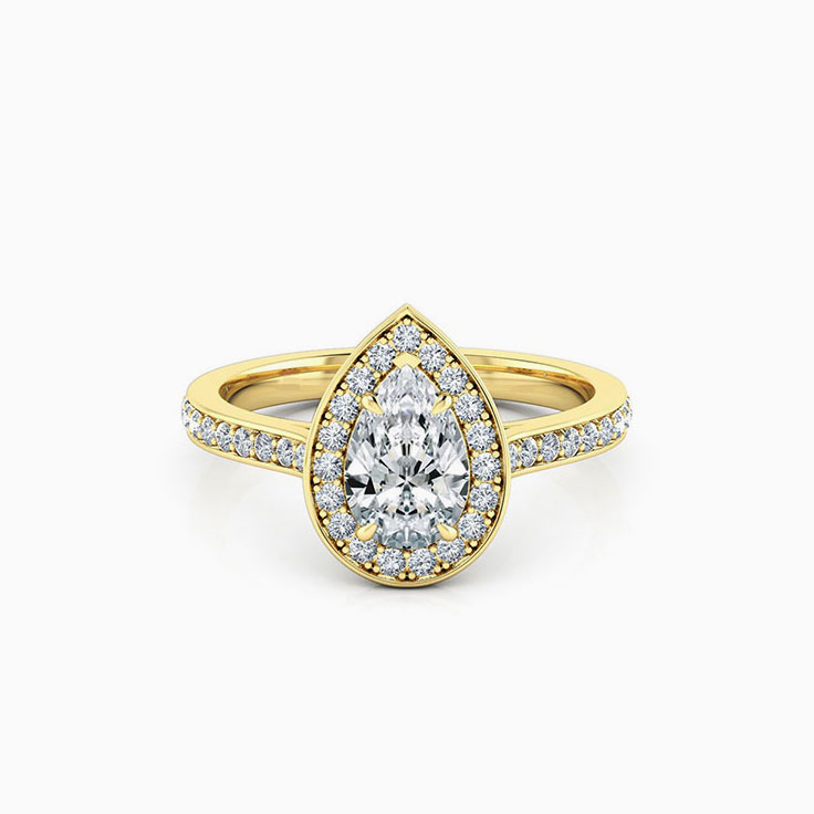 Pear cut diamond engagement ring with pave halo