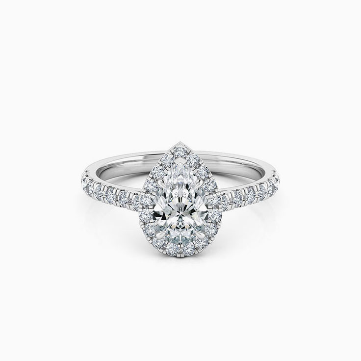 Pear cut diamond engagement ring with halo and diamond band