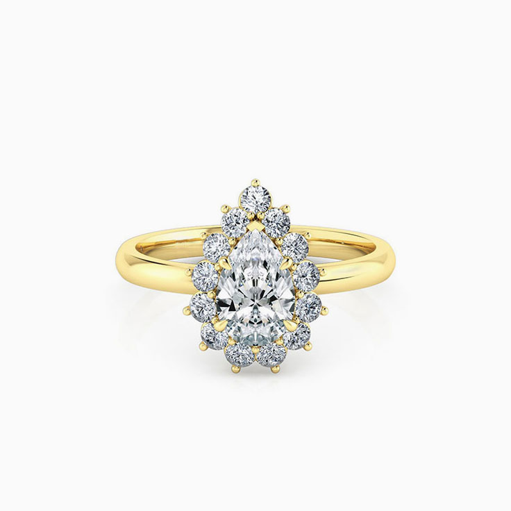 Pear cut diamond engagement ring with a floral diamond halo