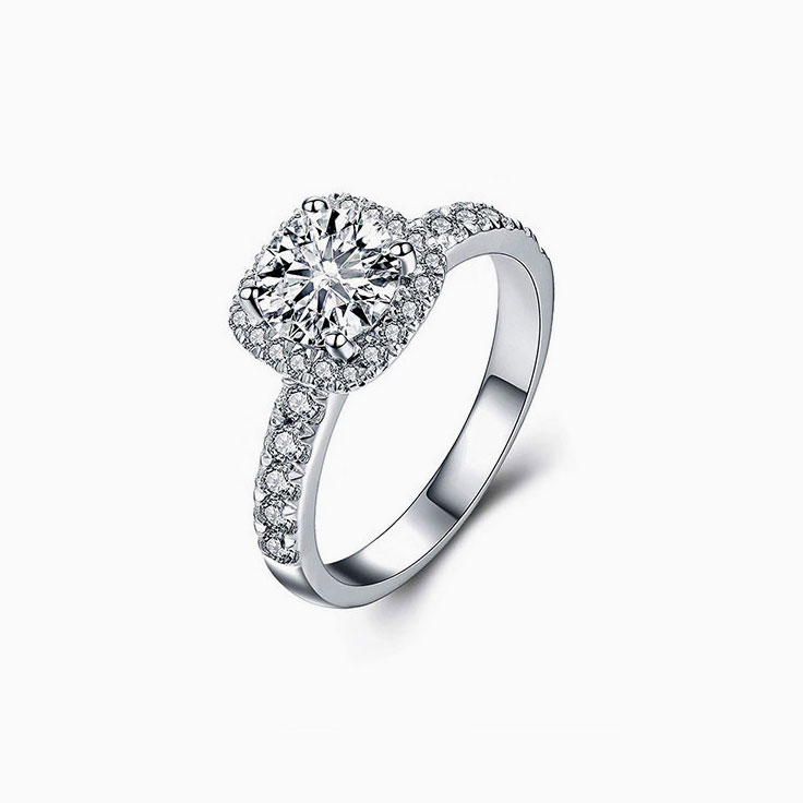 Round Diamond with a Cushion Halo Engagement Ring