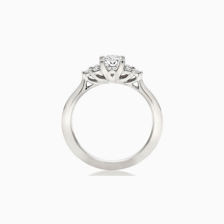 Trilogy setting Round brilliant Diamond Engagement ring