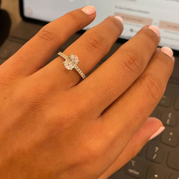 Oval Cut diamond Engagement ring on a diamond band